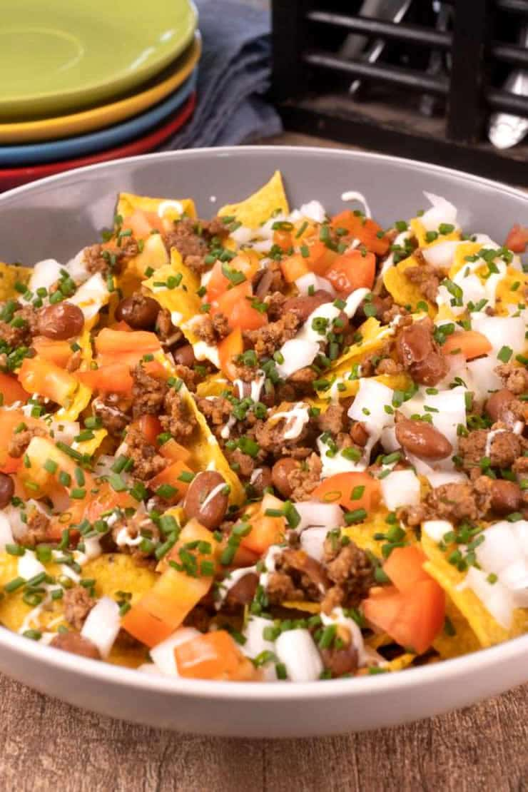 Doritos taco salad recipe you don't want to pass up! Easy homemade taco salad with Doritos chips. Nacho salad recipe for lunch, dinner, side dish or parties. Wow the party goers with this simple ingredient taco salad. Best taco salad with beans & chips. Top with sour cream or queso dip for the perfect dressing. Make the most amazing Doritos chips taco salad today.